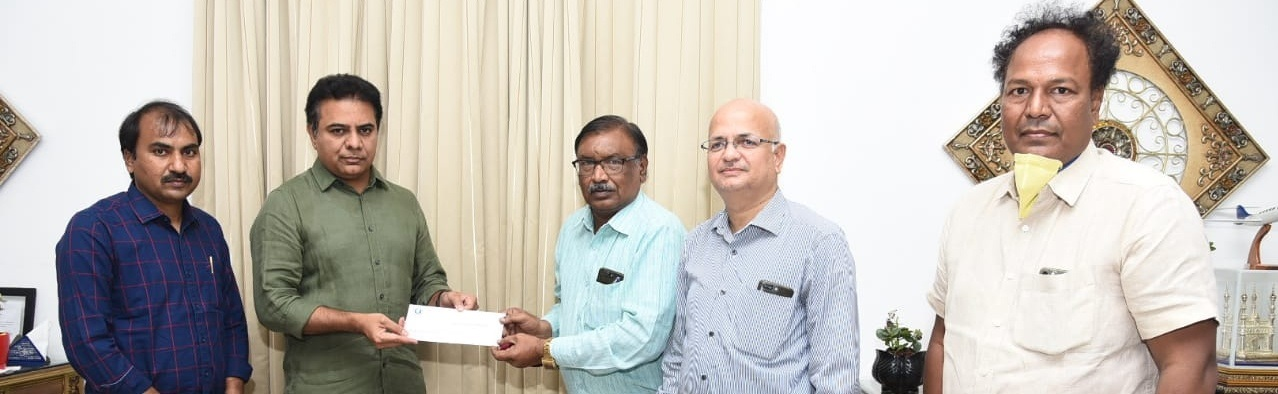 S NITIN, DIRECTOR KMIT, HANDING DONATION CHEQUE TO CM RELIEF FUND FOR COVID 19 TO HON' MINISTER SHRI KTR